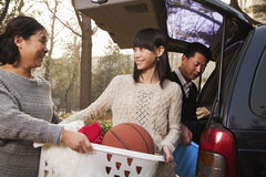 Smiling mother helping daughter unpack car for college, Beijing Royalty Free Stock Image