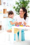 Smiling Mother Helps A Little Daughter To Sculpt Figurines From Plasticine. Children`s Creativity. Happy Family Stock Photography