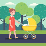 Smiling mother with her baby child in stroller Royalty Free Stock Photo