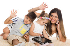 Smiling mother and her children Royalty Free Stock Images