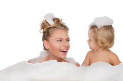 Smiling mother with her daughter and soap foam Royalty Free Stock Photography