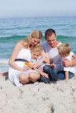 Smiling mother with her family holding sunscreen Royalty Free Stock Photos