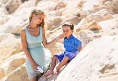 Smiling mother  and her little son. Yellow rocks and stones. Concept of mothers Day. Family outdoors portrait. Stock Image
