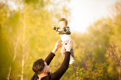 Smiling mother with her son in arms in the park Stock Photography