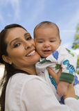 Smiling Mother Holding Baby Boy Stock Photos
