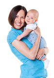 Smiling mother holding her baby Stock Photos