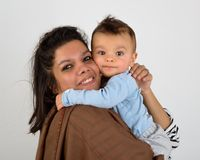 Smiling mother holding her baby royalty free stock photography