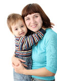 Smiling mother holds a child Stock Photos