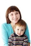 Smiling mother holds a child Royalty Free Stock Images