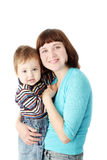Smiling mother holds a child Royalty Free Stock Photos