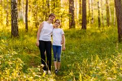 Smiling mother hugging daughter teen stock photography