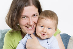 Smiling mother hugging her adorable baby boy. Stock Photo