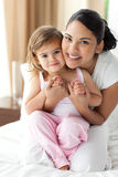 Smiling mother hugging her little girl Royalty Free Stock Images
