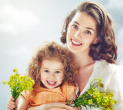Smiling mother and little child Stock Images