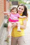Smiling mother with little daughter closeup Royalty Free Stock Photos