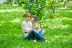 Smiling mother and little daughter on nature Royalty Free Stock Photos