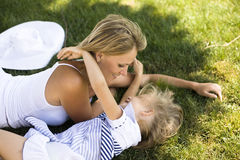 Smiling mother and little daughter on nature. Happy people outdoors Royalty Free Stock Photo