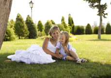 Smiling mother and little daughter on nature. Happy people outdoors Royalty Free Stock Photography