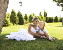Smiling mother and little daughter on nature. Happy people outdoors Royalty Free Stock Images