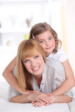 Smiling mother with little girl Stock Images