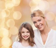 Smiling mother and little girl Royalty Free Stock Image