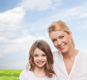 Smiling mother and little girl Stock Photography