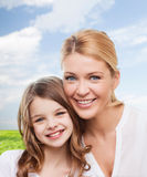 Smiling mother and little girl Royalty Free Stock Photo