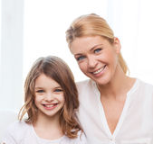 Smiling mother and little girl with laptop at home royalty free stock photos