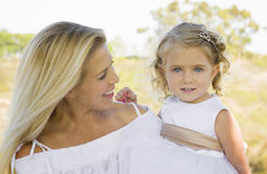 Smiling Mother Lovingly Looks at Daughter Royalty Free Stock Images