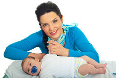 Smiling mother with newborn baby Stock Photos