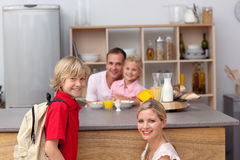 Smiling mother packing the school lunch to his son Royalty Free Stock Photography