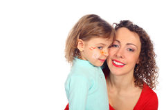 Smiling mother and painted child Stock Photography