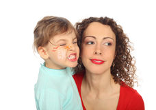 Smiling mother and painted child Royalty Free Stock Photo