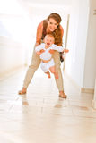 Smiling mother playing with her adorable baby Royalty Free Stock Photo