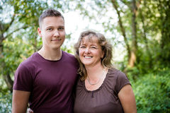 Smiling mother posing with adult son, outdoors. Stock Image