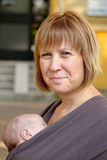 Smiling Mother and Slepping Baby Stock Photography
