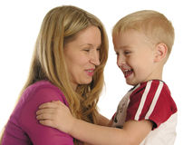Smiling mother with son. Isolated stock images