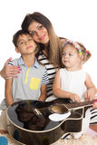 Smiling mother with son and daughter Stock Photo