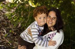 Smiling mother and son holding each other Stock Image