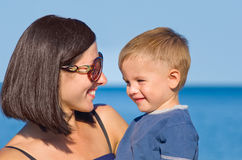 Smiling mother and son. Portrait of a smiling mother and son looking at each other Stock Image