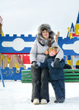 Smiling mother and son in a winter playground Royalty Free Stock Photography