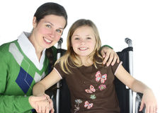 Smiling Mother with Special Needs Child Stock Images