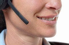 Smiling mouth of a friendly telephone operator royalty free stock image