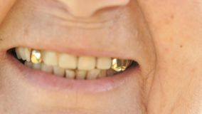 Smiling mouth of mature old woman with false teeth stock video footage