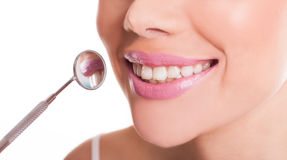 Smiling mouth of a woman showing her healthy teeth Stock Photo