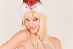 Smiling mrs. Santa. In red hat royalty free stock photos