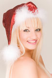 Smiling mrs. Santa. In red hat stock photos