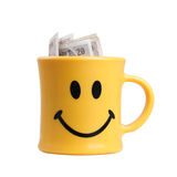 Smiling mug with money Royalty Free Stock Image
