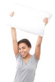 Smiling mulatto girl holding pillow up Royalty Free Stock Photography