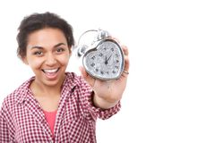 Smiling mulatto girl showing alarm clock Royalty Free Stock Photography